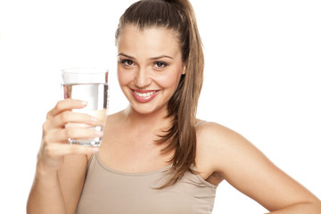 happy woman holds a glass with water on white background