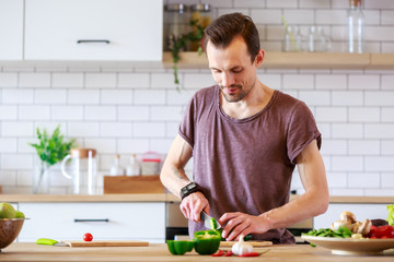 Image of brunet cooking vegetables on table