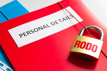 Rodo personal data protection with padlock and personal details concept