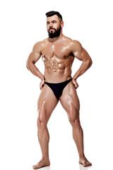 strong bodybuilder posing in studio