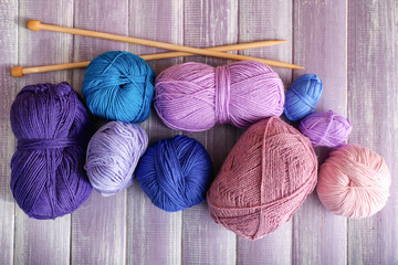 Knitting yarn with needles on wooden table