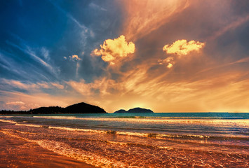 Sunset in a beautiful tropical beach with people enjoy outdoor life in Hainan island  -  China