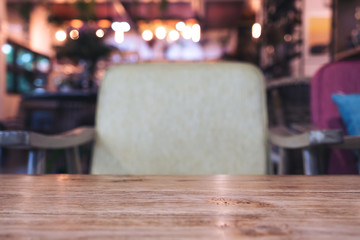 Wooden table and chair in cafe with blur bokeh background