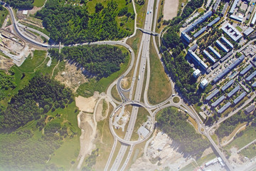 Freeway and roundabout pattern with traffic aerial