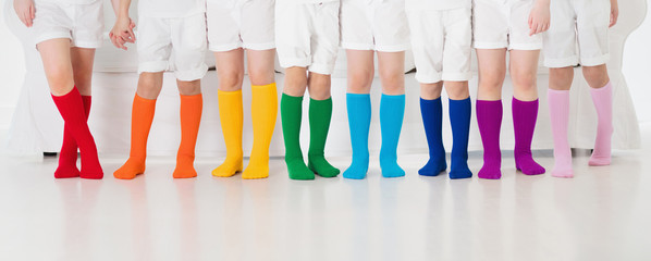 Kids with colorful socks. Children footwear.