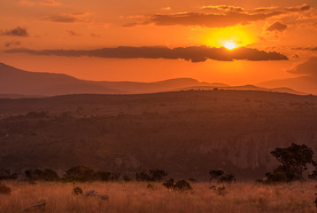 A golden orange sunset over the hills and savannah at Blyde River Canyon in Mpumalanga, South Africa