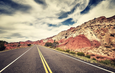 Retro toned picture of a scenic road in the Capitol Reef National Park, Utah, USA.