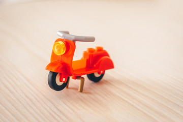 Toy plastic scooter on the table