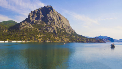 Foto op Aluminium Reflectie The mountain called Sokol is reflected in the blue waters of the sea Bay.Crimea.
