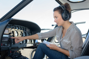 woman pilots flying a helicopter