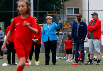"German Chancellor Angela Merkel visits the SV Rot-Weiss Viktoria Mitte 08, as part of the ""Sports and Integration"" event in Berlin"