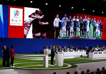 Delegates watch the presentation of the joint bid of United States, Canada and Mexico to host the 2026 FIFA World Cup during the 68th FIFA Congress in Moscow