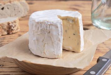 cheese and Iberian chorizo on rustic board
