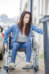 disabled woman rides a wheelchair