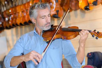 tuning the violin