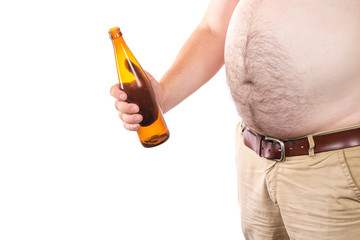 Fat man with big belly holding bottle of beer isolated on white background. Alcohol abuse concept.