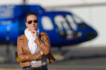 female in front of a helicopter