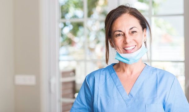 Middle aged doctor woman with a happy face standing and smiling with a confident smile showing teeth