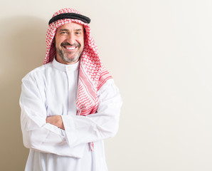 Senior arabic man with a happy face standing and smiling with a confident smile showing teeth
