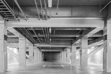 Parking garage underground interior, neon lights at night..