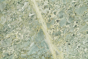 Light green marble texture with light veins and spots. Perfect natural pattern for background or tile