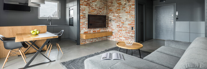 Home interior with brick wall