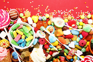 Photo sur Aluminium Confiserie candies with jelly and sugar. colorful array of different childs sweets and treats