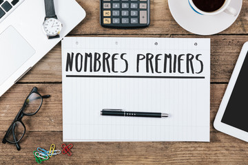 French text nombres premiers (prime numbers) on note pad at office desktop