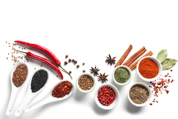 Composition with various spices on white background Wall mural