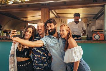 Millennial friends group taking selfie.