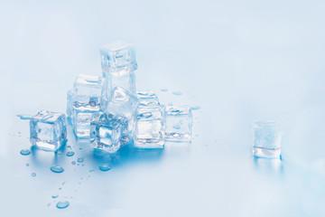 Freshness ice cubes isolated on blue. Close up. Fototapete