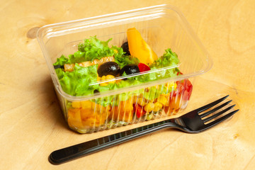Vegetable salad in a plastic box.