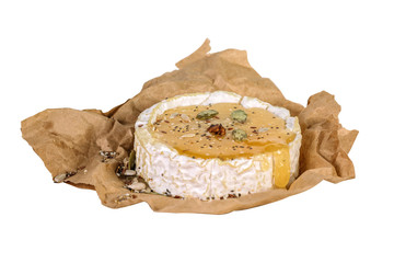 Piece of Camembert with honey and seeds