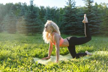 Photo of sportswoman exercising on rug