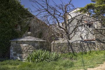 Grisignana, Central Istria, Croatia - Medieval rainwater tank in an old stone house backyard
