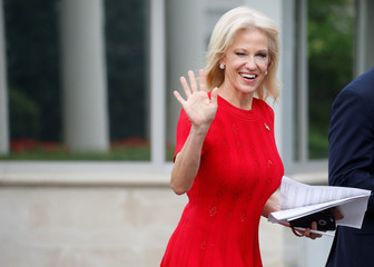 White House counselor Kellyanne Conway winks and waves at the news media as she goes to make a TV appearance at the White House in Washington, D.C., U.S.
