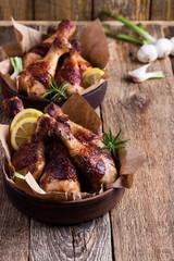 Chicken drumsticks in ceramic bowl, favorite meal