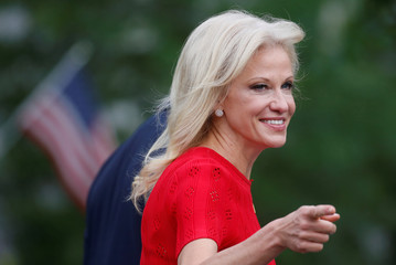 White House counselor Kellyanne Conway smiles at the news media as she goes to make a TV appearance at the White House in Washington, D.C., U.S.