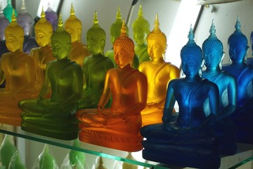 Colorful Buddha figures in a shop in Bangkok, Thailand