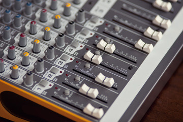 Audio studio sound mixer equalizer board sliders, faders and knobs
