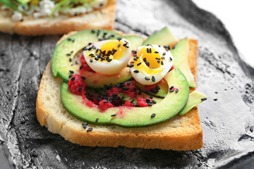 Tasty toast with avocado on plate, closeup