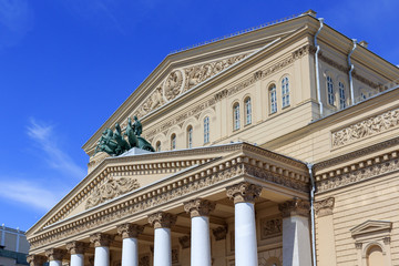 Facade of Bolshoi Theatre closeup on a blue sky background on a sunny summer morning