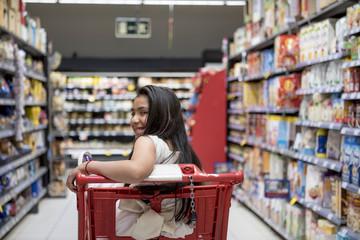 Little girl posing at the Supermarket