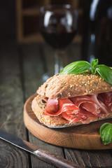 Sandwich with jamon serrano and basil