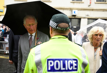 Britain's Prince Charles and Camilla, the Duchess of Cornwall, greet first responders to the Omagh bombing, in Omagh, Northern Ireland