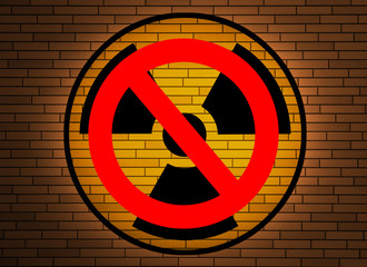Stop nuclear -  radiation sign on a brick wall.
