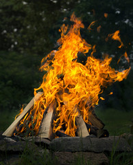 Fire at the camp side. Travel and adventure concept