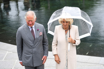 Britain's Prince Charles and Camilla, the Duchess of Cornwall, stand in the memorial garden for the victims of the Omagh bombing, in Omagh, Northern Ireland