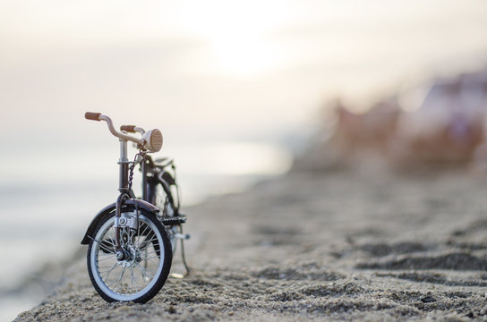 bicycle toy on beach sunset time holiday