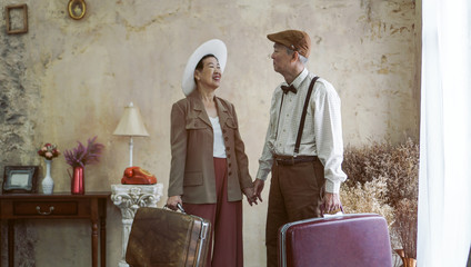 Vintage retro fashion Asian senior couple travel luxury trip after retirement life